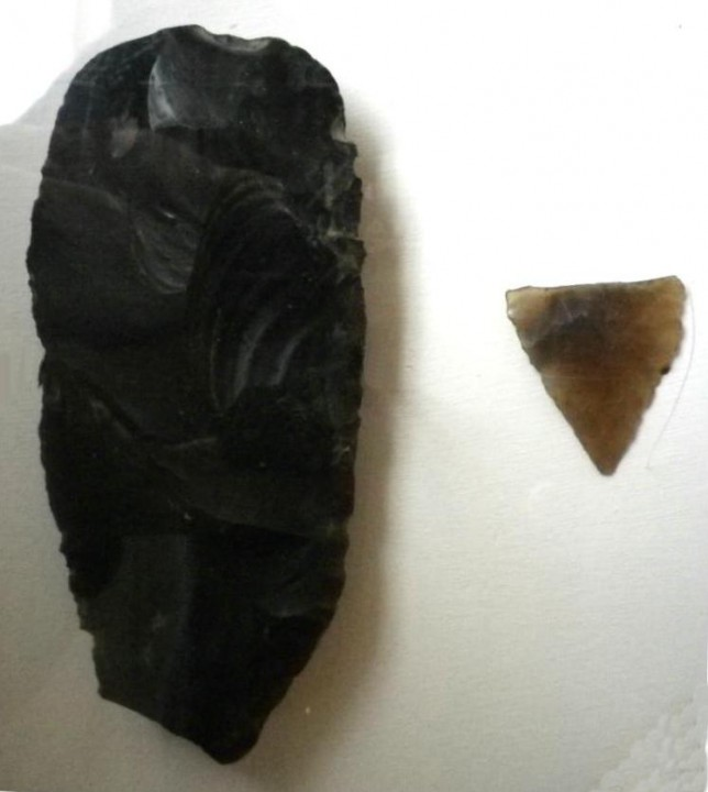 Typical Neolithic arrowhead and partly worked axe or celt Copyright: Michael Daniels